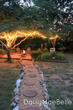 The easy walking path leading to the main attraction of this back yard feels like an enjoyable escape would. The tree lighting is essential for hanging out after dark.