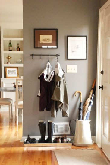 This ENTRYWAY allows style to follow function. I like that guests know where they can hang their outerwear's once entering your home. A boot tray by the door lets your guests know whether or not shoes are allowed on beyond the door. Source: http://thecurtiscasa.com/2013/03/home-tour-morrows-cottage-style-ranch.html/?m=0